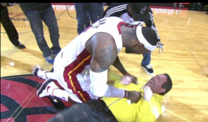 LeBron James bear hugs a fan who hit a half-court shot worth $75,000 (VIDEO)